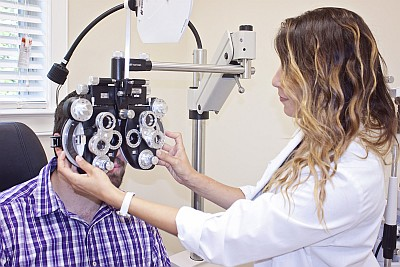 Dr. Miki Lyn D'Angelo performing an eye exam