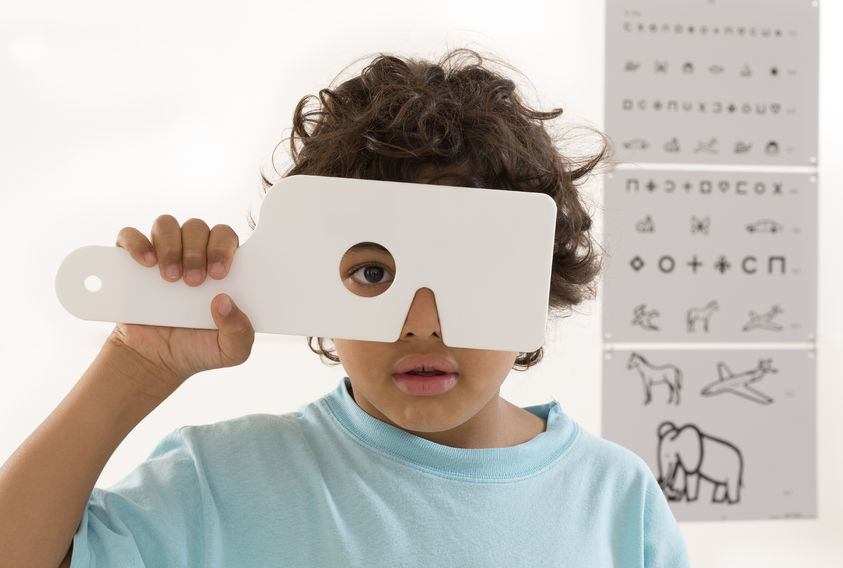 Pediatric Eye Care: Young Boy having his eyes checked